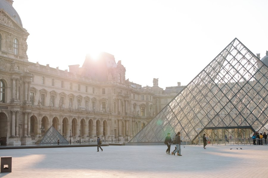 Pyramid near the Louvre Museum in the early morning sunlight.